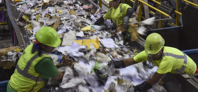 ELKRIDGE, MD - JUNE 18: Workers are seen sorting as the conveyo